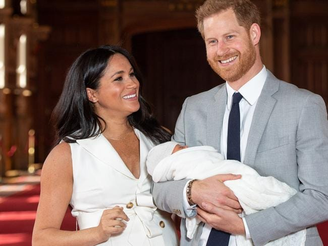 Prince Harry, Duke of Sussex and Meghan, Duchess of Sussex, pose with their newborn son.