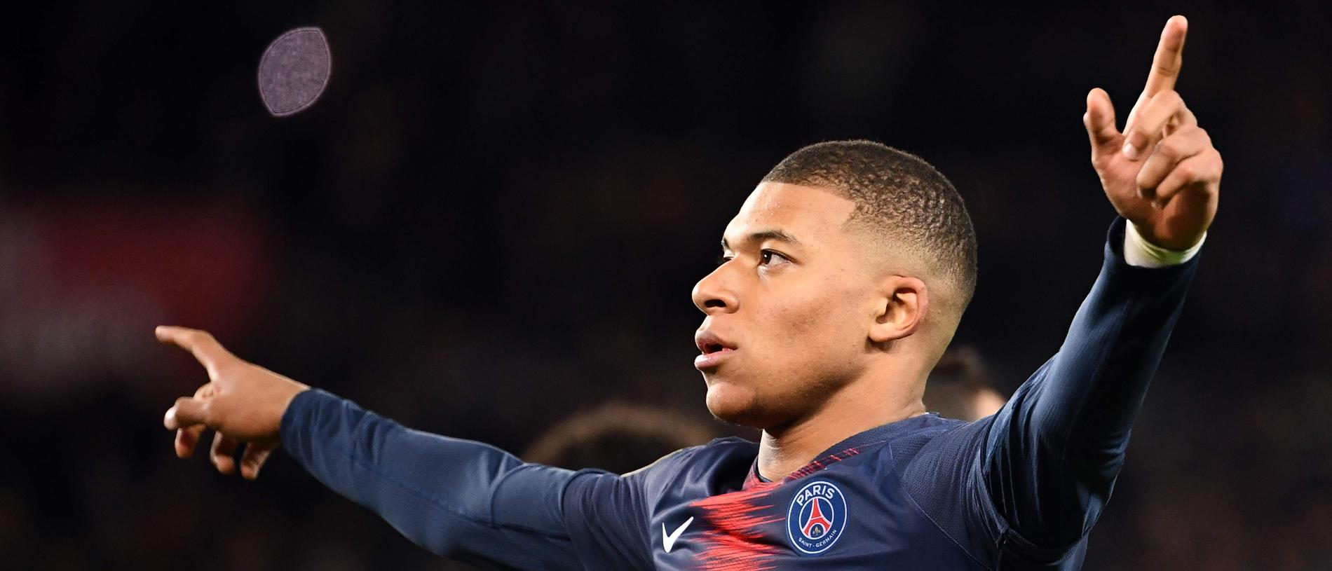 Paris Saint-Germain's French forward Kylian Mbappe celebrates after scoring a goal during the French L1 football match Paris Saint-Germain (PSG) vs Olympique de Marseille (OM), on March 17, 2019 at the Parc des Princes stadium in Paris. (Photo by FRANCK FIFE / AFP)