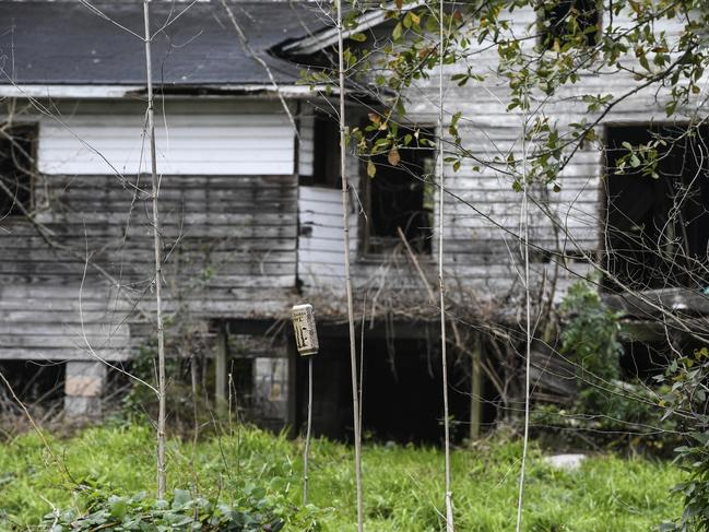 A dilapidated home can be seen from neighbouring Old Plateau Cemetery, the final resting place for many who spent their lives in Africatown, near Mobile, Albama. Picture; AP