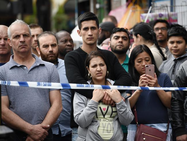Members of the public view the scene after police officers raided a property in East Ham. Picture: Getty