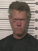 Randy Travis is seen in a police booking photo August 7, 2012 in Sherman, Texas. Travis was charged with misdemeanor DWI and felony Retaliation after he was involved in a one vehicle accident. He was later released on bond. (Photo by Grayson County Sheriff's Office via WireImage)