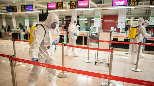 The disinfection process at the airport. Picture: David Ramos/Getty Images.