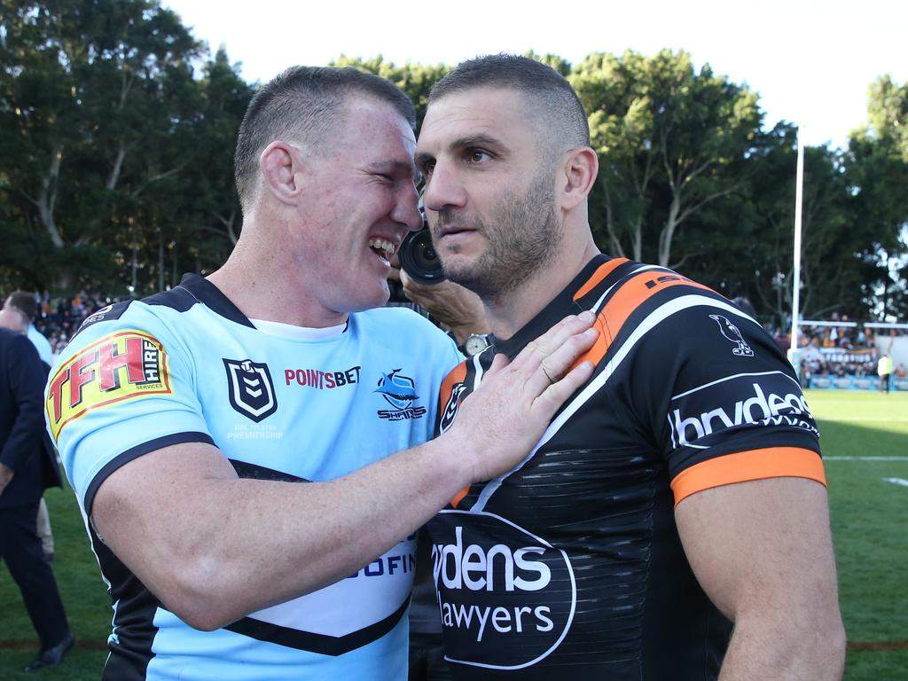 Paul Gallen of the Sharks and Robbie Farah of the Tigers after the Round 25 NRL match between the Wests Tigers and the Cronulla Sharks at Leichhardt Oval in Sydney, Sunday, September 8, 2019. (AAP Image/Craig Golding) NO ARCHIVING, EDITORIAL USE ONLY