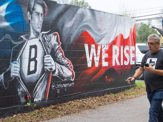 A pedestrian passes the new mural of Beto O'Rourke in Austin, Texas. Picture: AFP