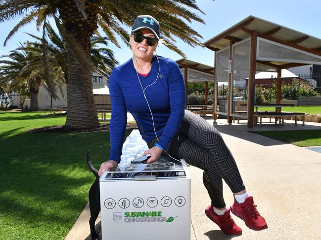 Catrina Ingram at the Rotary Park 'smartbench'. Picture: AAP / Keryn Stevens