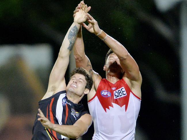 Patrick Mitchell (right) contests a mark.