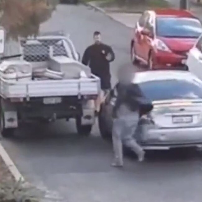 CCTV footage shows the driver of the Ford Falcon running after the tradie. Picture: 7 News