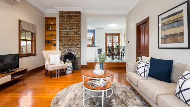 There is an exposed brick fireplace.