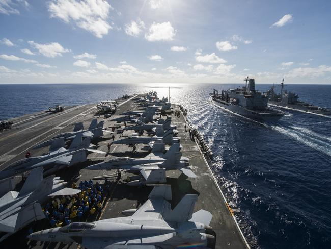Team America ... The United States is repositioning more warships, aircraft and troops in the South-East Asia region to 'counterbalance' China's growing might. Source: USN