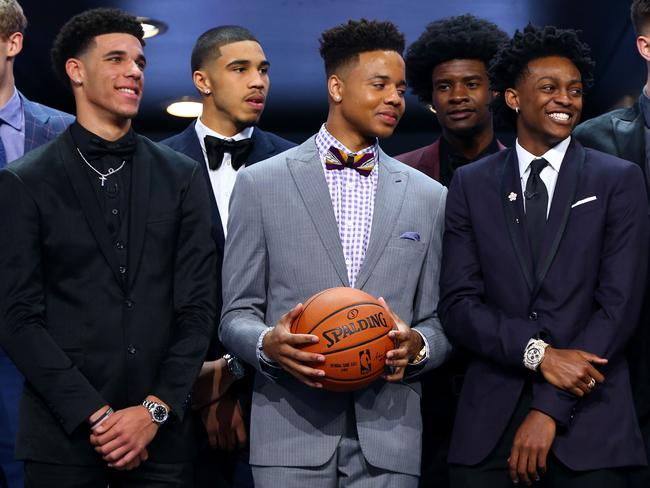 Top draftees Lonzo Ball (L), Markelle Fultz (C) and De'Aaron Fox (R).