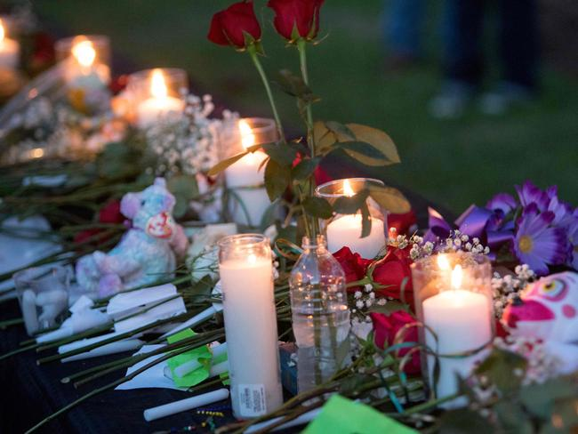 Tributes were laid at a vigil in Santa Fe, Texas for the victims of the mass shooting. Dimitrios Pagourtzis, the 17-year-old shooter, is being held on capital murder charges, meaning he could face the death penalty. / AFP PHOTO