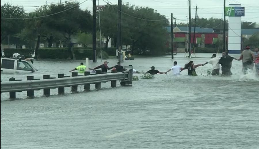 Houston Residents Form Human Chain to Save Man Trapped in SUV. Credit - Facebook/Stephanie N Edward Mata via Storyful