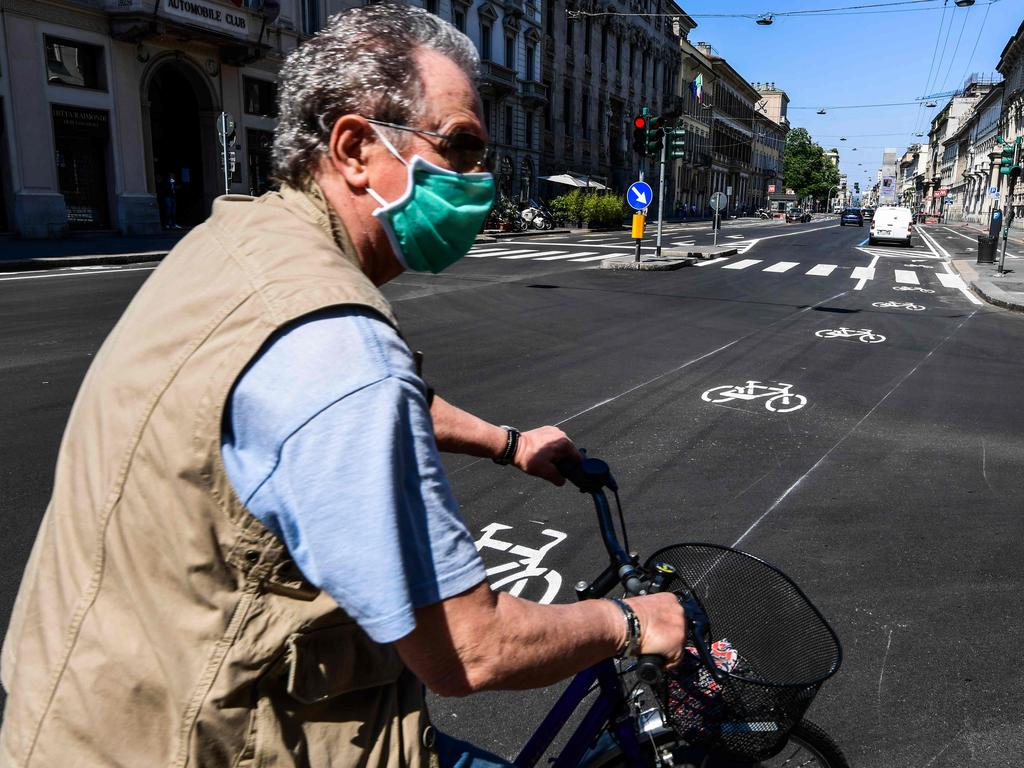 A man rides a bicycle through central Milan as Italy starts to ease its lockdown. Picture: AFP