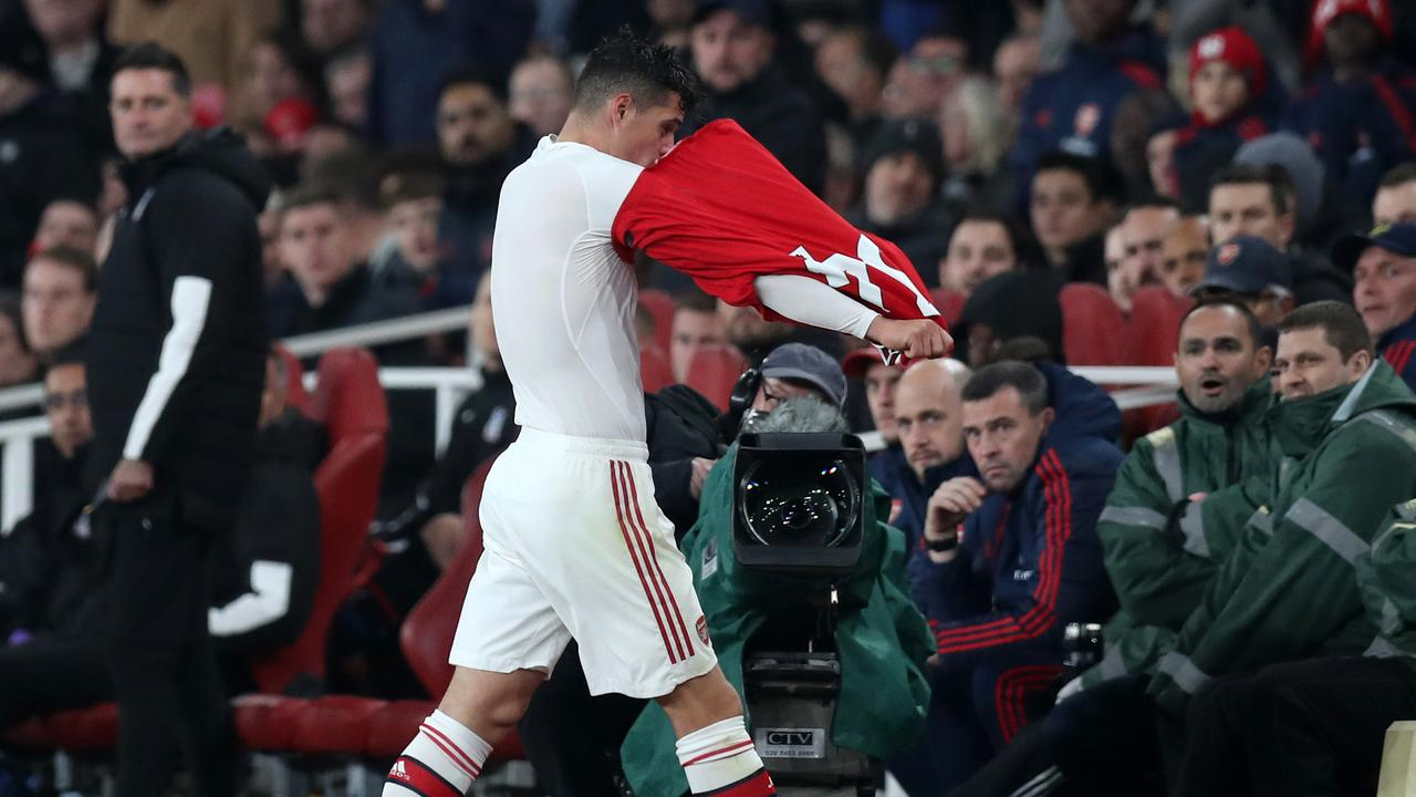 Granit Xhaka leaves the pitch after being substituted.