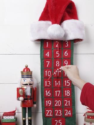 Reaching into the advent calendar. Picture: iStock