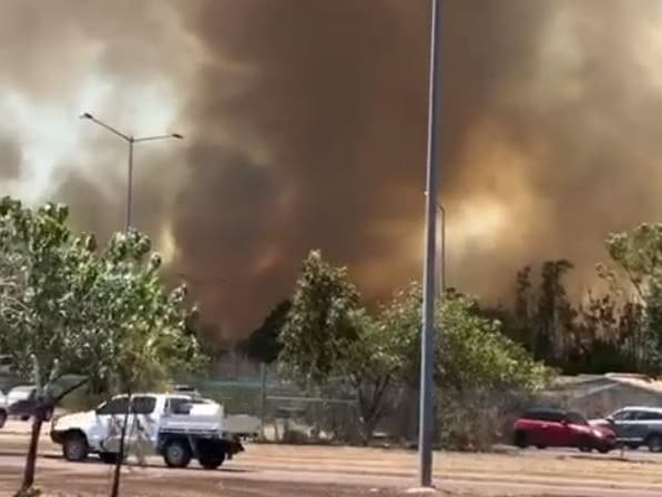 Fire crews are battling a large grass fire near Darwin Airport