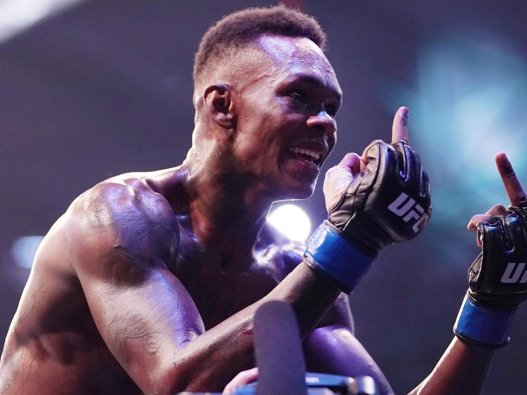 Israel Adesanya of New Zealand gestures to his next opponent after winning against Robert Whittaker of Australia during UFC 243 at Marvel Stadium in Melbourne, Sunday, October 6, 2019. (AAP Image/Michael Dodge) NO ARCHIVING,EDITORIAL USE ONLY