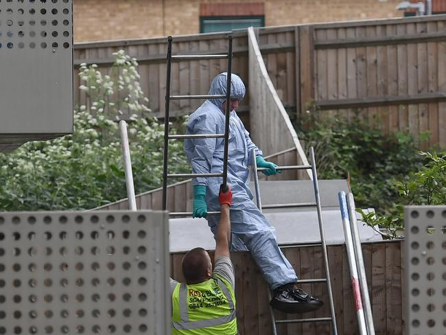 A forensic police officer works at block of flats which has been raided by police in Barking. Picture: Getty