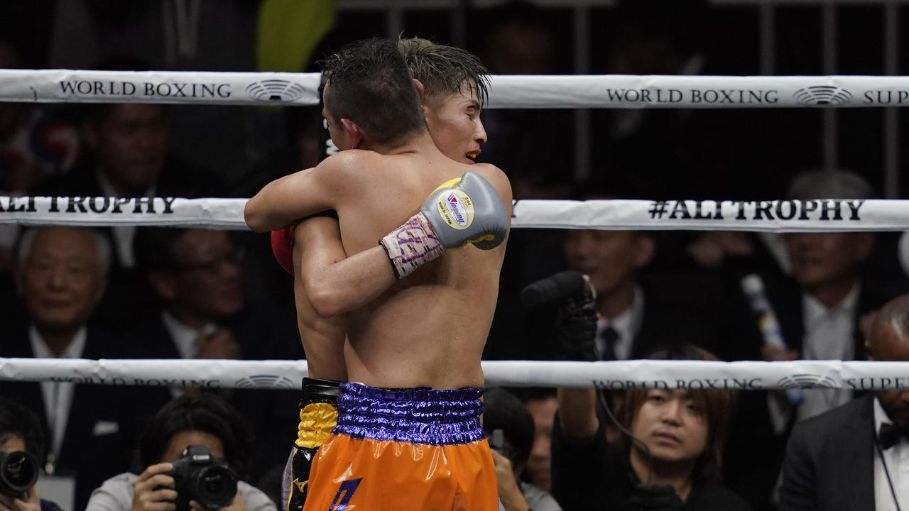 The boxers embrace after an epic fight.