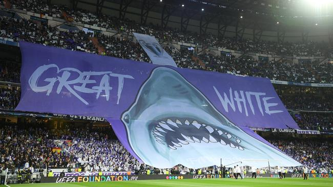 Real Madrid fans display a large banner of a Great White Shark