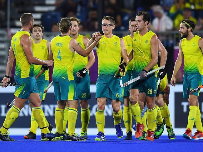 Australia's Matthew Dawson (C) celebrates with teammates
