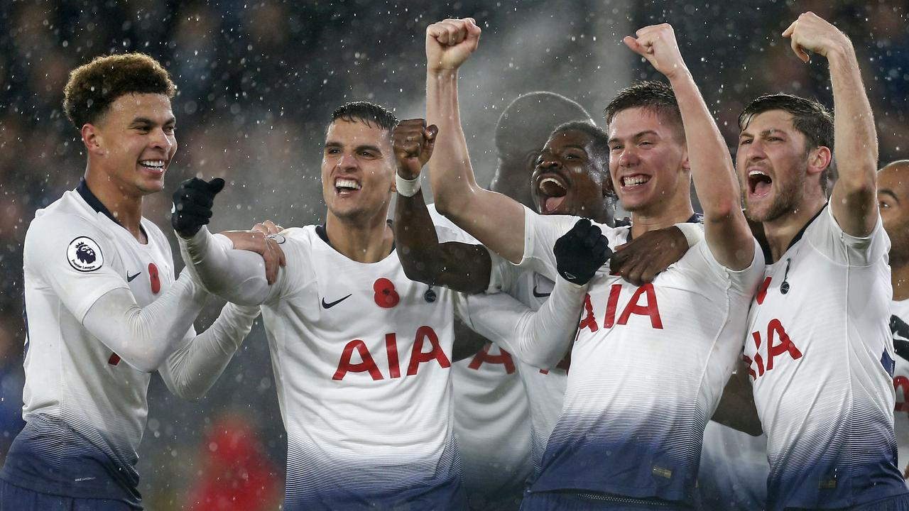 Tottenham Hotspur's Argentinian defender Juan Foyth (2nd R) celebrates with teammates after scoring the opening goal