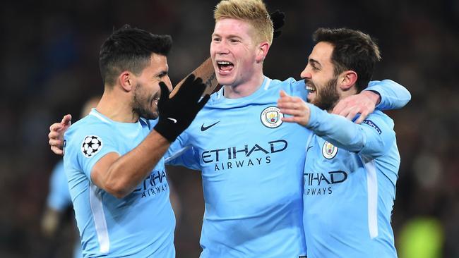 Manchester City's Sergio Aguero (L) celebrates with Kevin De Bruyne and Bernardo Silva.