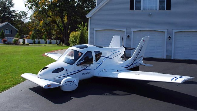 Futurologist Thomas Frey says flying cars, like this one from Terrafugia Transition, might not be a hit on the mass market, mainly mainly because humans are idiots and can't drive very well.