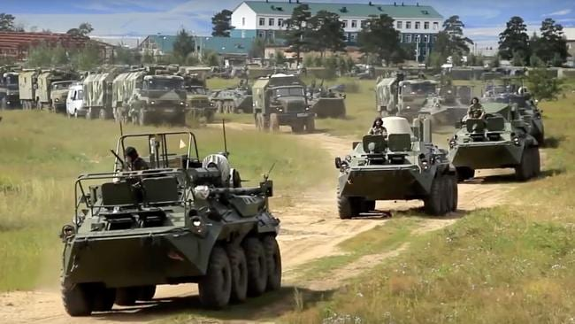 In this screengrab provided by Russian Defence Ministry, the country's armoured personnel carriers roll during the military exercises in the Chita region, Eastern Siberia, during the Vostok 2018 exercises in Russia.