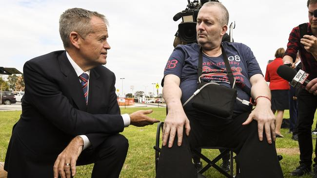 Bill Shorten speaks to cancer patient Rob Gibbs at the end of a press conference outside Casey Hospital. Picture: AAP