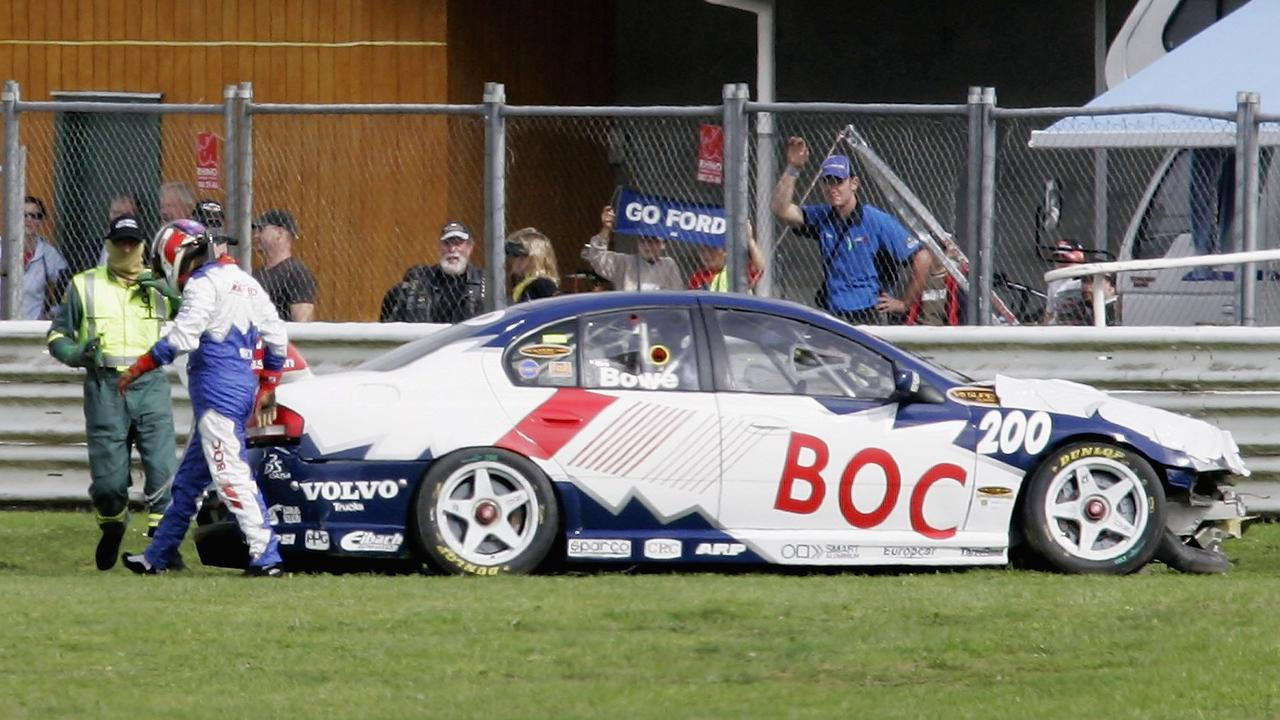 Bowe walks away from his car after a heavy crash in 2006.