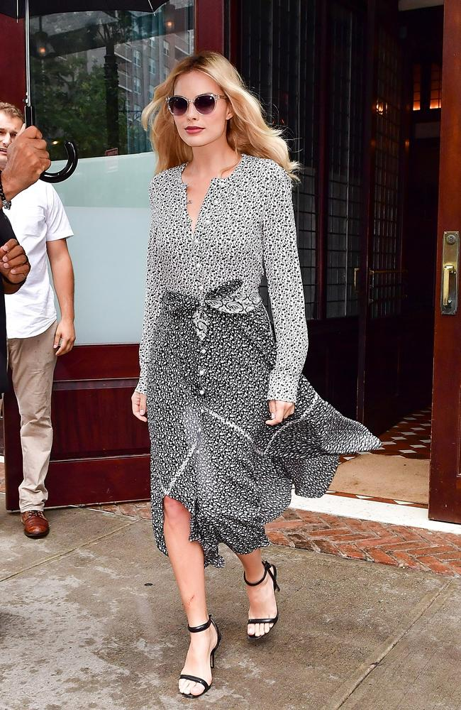 Margot Robbie wearing a monochrome shirt dress in New York today. Picture: James Devaney/GC Images