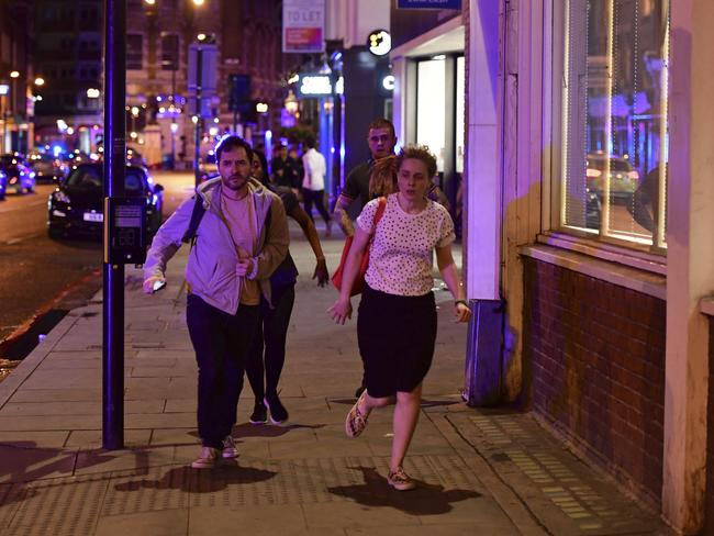 Members of the public were told to run away as fast as possible. Picture: Dominic Lipinski/PA via AP)
