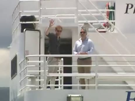 Prince Harry waves to his fans as he boards the barge to Fraser Island. Image: Channel 9