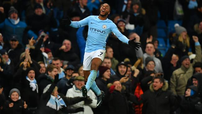 Raheem Sterling of Manchester City celebrates his stunning winner.