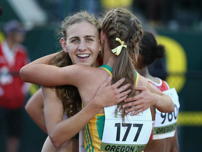 Mary Cain hugs Australia's Jessica Hull after winning the women's 3000m final at the World Juniors. (Photo by Christian Petersen/Getty Images)
