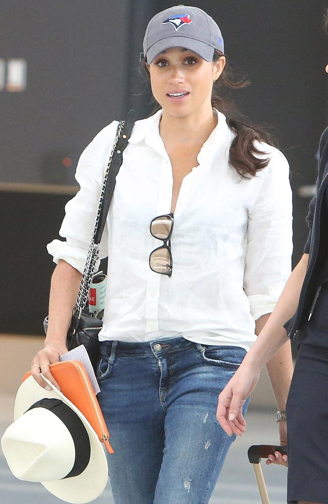 Meghan pictured catching a flight to London out of Toronto while she was dating Prince Harry. Picture: Splash