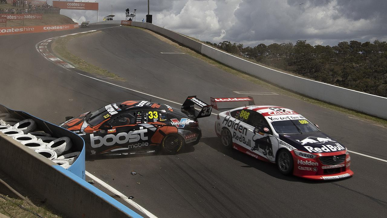 Richie Stanaway crashes as Jamie Whincup looks to avoid contact. Picture: Andy Pearson