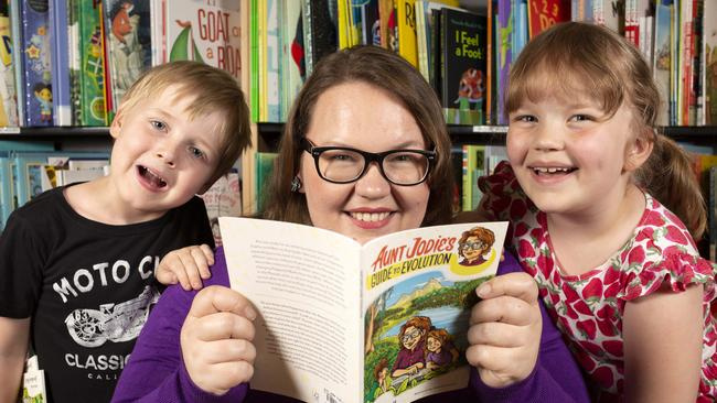 "Dr Jordan Bell reading her new book ""Aunt Jodie's Guide to Evolution"" to children including her daughter Ruby, 6, and Hamish, 6 in the children's corner at ""Booked"" in North Adelaide. Picture: Emma Brasier"