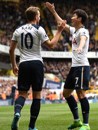 Heung-Min Son of Tottenham Hotspur celebrates scoring his sides second goal with Harry Kane.