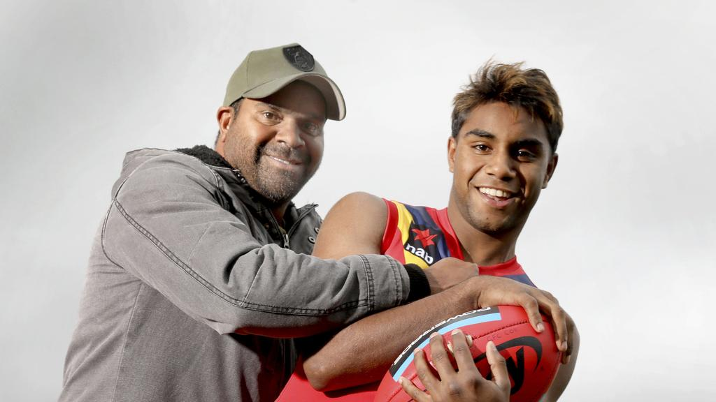 Kysaiah Pickett with his uncle Byron Pickett, who won the 2004 Norm Smith Medal.