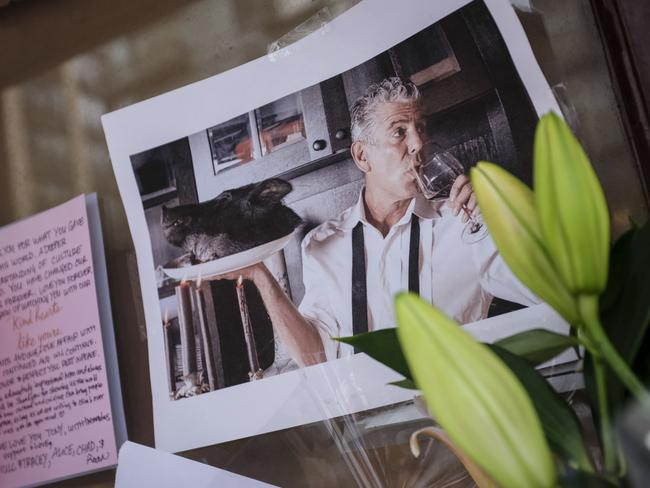 Notes, photographs and flowers left in memory of Bourdain at the closed Brasserie Les Halles, where he used to work as the executive chef. Picture: Drew Angerer/Getty Images/AFP