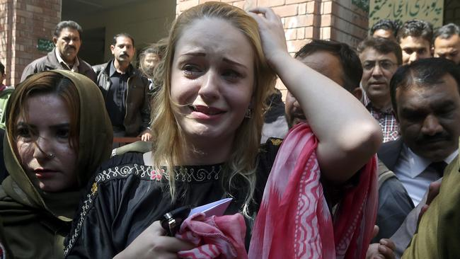 Czech model Tereza Hluskova weeps after a court in Lahore, Pakistan sentenced her to more than eight years in prison.
