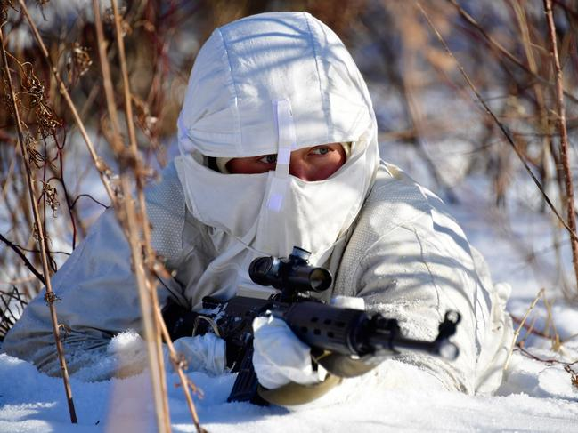 A serviceman with a rifle during military exercises conducted by the Russian Pacific Fleet's naval infantry unit at the Bamburovo firing range. Picture: Getty