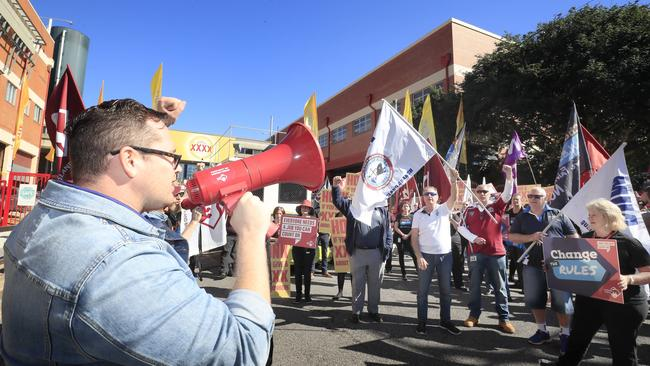 XXXX Brewery workers strike, block trucks from Milton site
