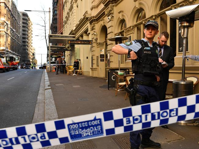 Police gather at the Clarence St apartments. Picture: Saeed Khan/AFP
