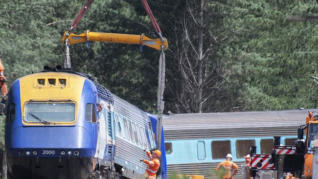 A sling on a crane is used to move part of the XPT train that derailed. Picture: Ellen Smith/AAP Image