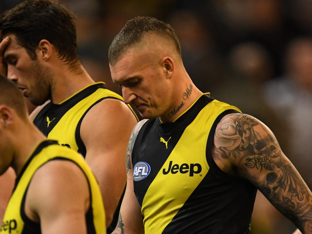 Dustin Martin of the Tigers (second from right) reacts after the first half during the First Preliminary Final between the Richmond Tigers and the Collingwood Magpies in Week 3 of the AFL Finals Series at the MCG in Melbourne, Friday, September 21, 2018. (AAP Image/Julian Smith) NO ARCHIVING, EDITORIAL USE ONLY