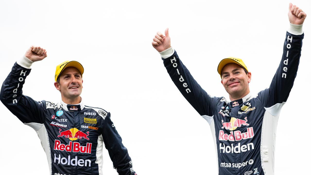 Jamie Whincup and Craig Lowndes celebrate after winning the Sandown 500. Picture: Daniel Kalisz
