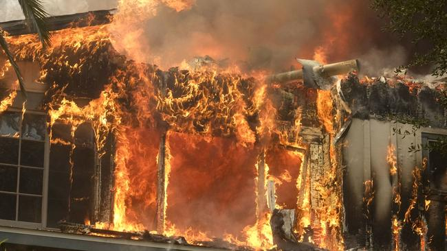 A home burns by Malibu Lake, Malibu. Picture: Ringo H.W. Chiu